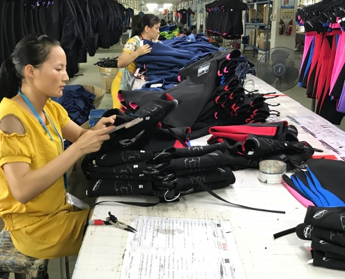 Finishing own brand wetsuits in the TWF Factory