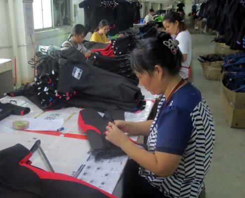 Hand finishing wetsuits